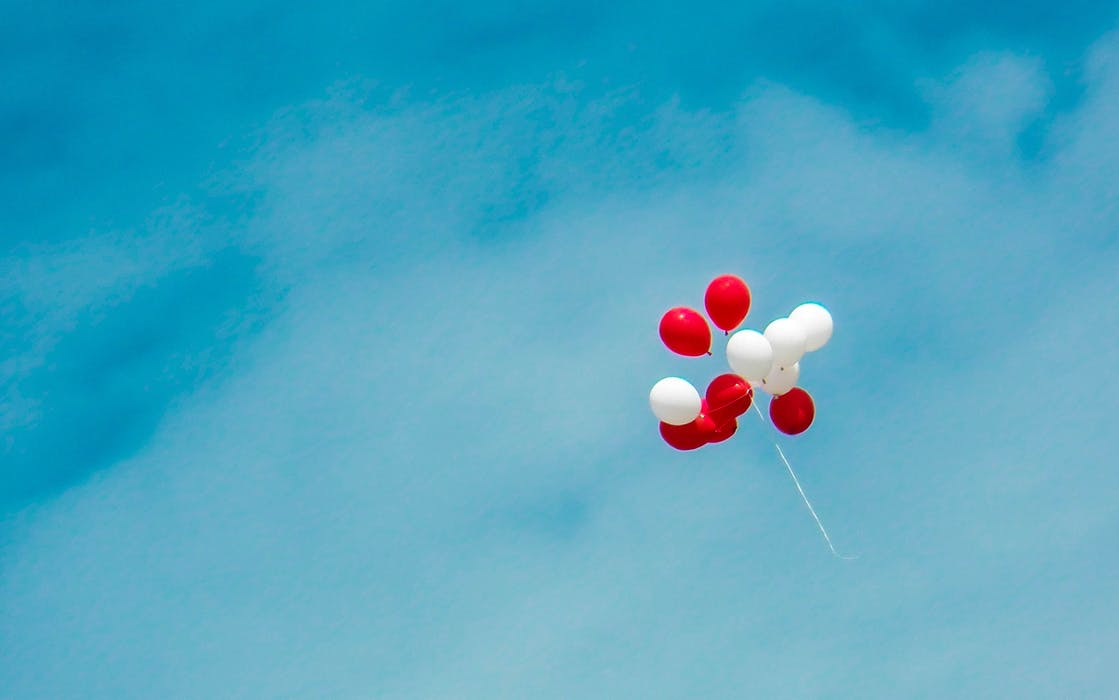 red and white helium balloons