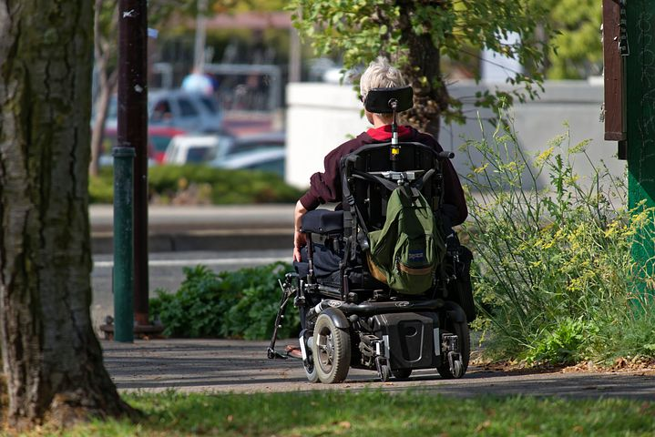 teenage man in a wheelchair