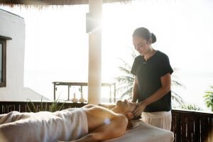 massage therapist massaging a man
