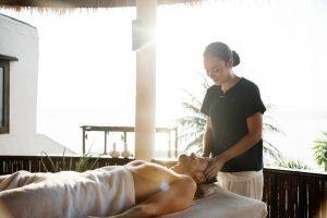 massage therapist massaging a man