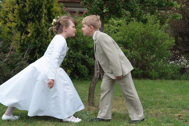 girl in a dress, and a boy wearing a suit